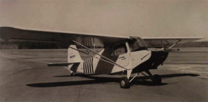 N83845, Aeronca AC7. The GATech Flying Club logo can be seen on the door. Circa 1952.